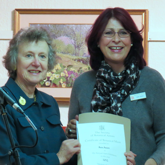 Ann Swan (right) receiving a Certificate of Botanical Merit from Elizabeth Banks DL, the then President of the Royal Horticultural Society,