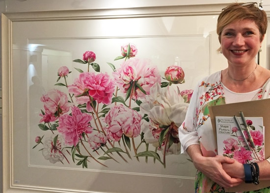 Billy Showell with her painting of peonies which was on the cover of the catalogue for the 2016 Annual Exhibition of the Society of Botanical Artists
