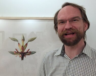 Martin Allen with his painting of horse chestnut buds at the 'British Artists in the Shirley Sherwood Collection' exhibition at Kew in 2016