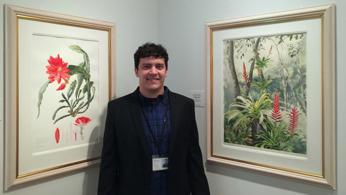 Gustavo Marigo with two of his paintings bought by Shirley Sherwood for her collection - at the 'Brazil - a Powerhouse of Plants' exhibition in 2016